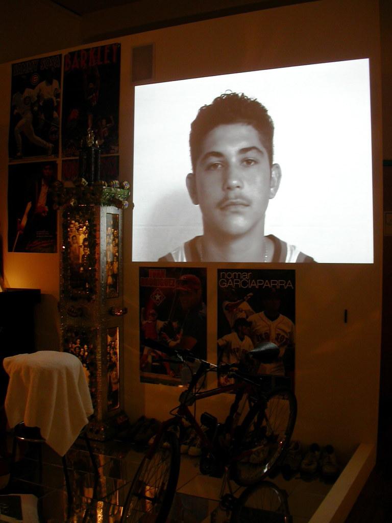 Boy's face shown on video screen in dark room