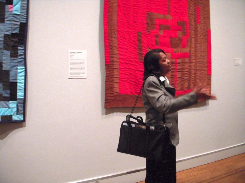 Louisiana P. Bendolph, speaking in front of her quilt