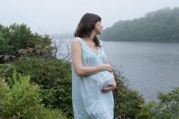 Woman by lake