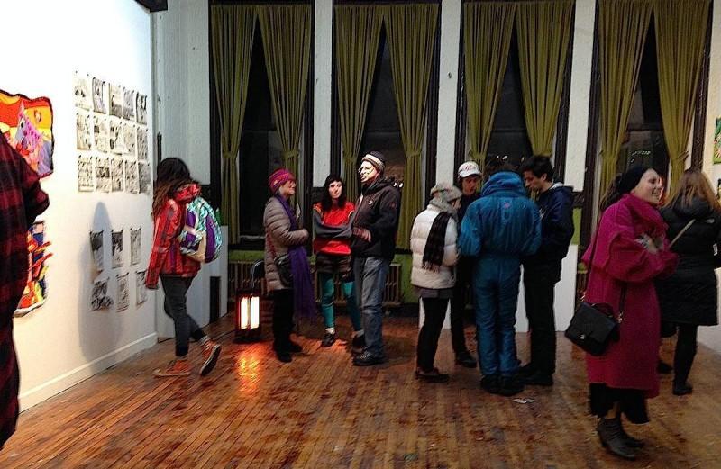 crowd looking at drawings Space 1026