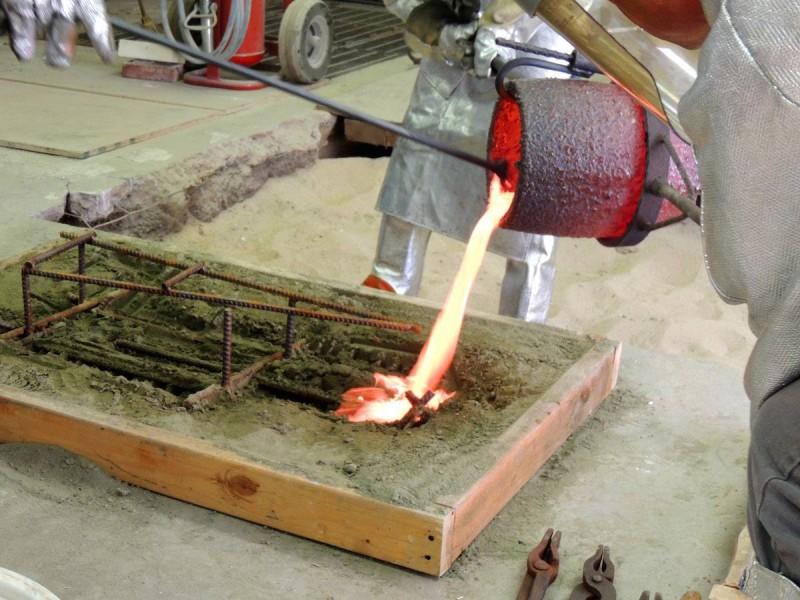 Tyler Kline pouring bronze
