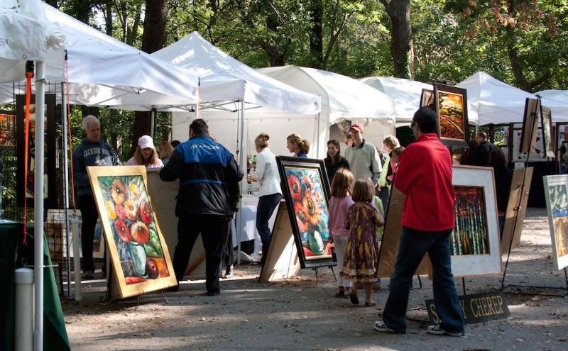Many art booths at an outdoor art fair
