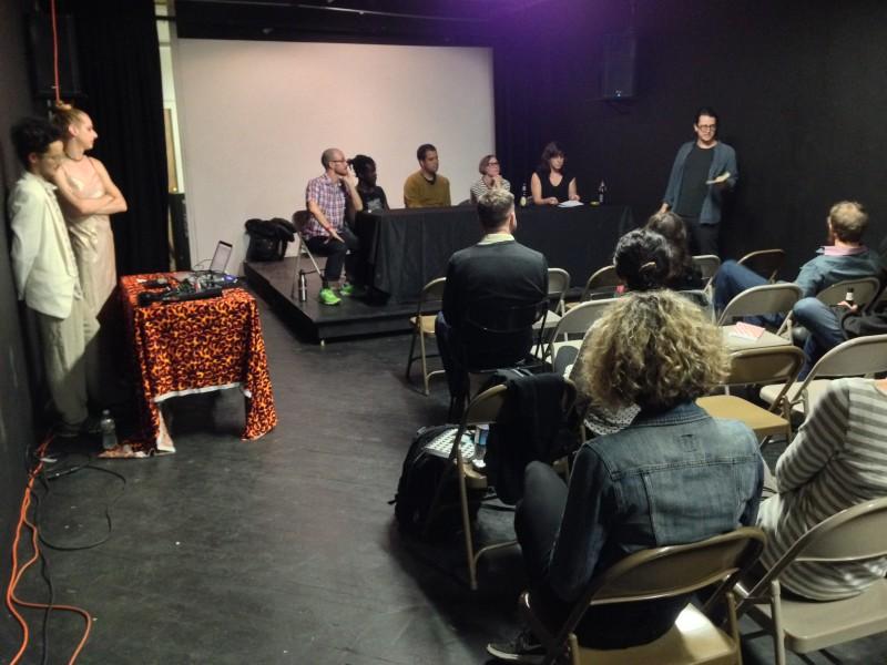 Panelists and musicians listen to MC Matt Kalasky