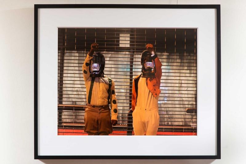 Amber Art & Design, Urban Space Jockey, photo series of three digital prints, each 22'' x 30.'' Photos by Taji Nahl, Performance by Ernel Martinez and Keir Johnston