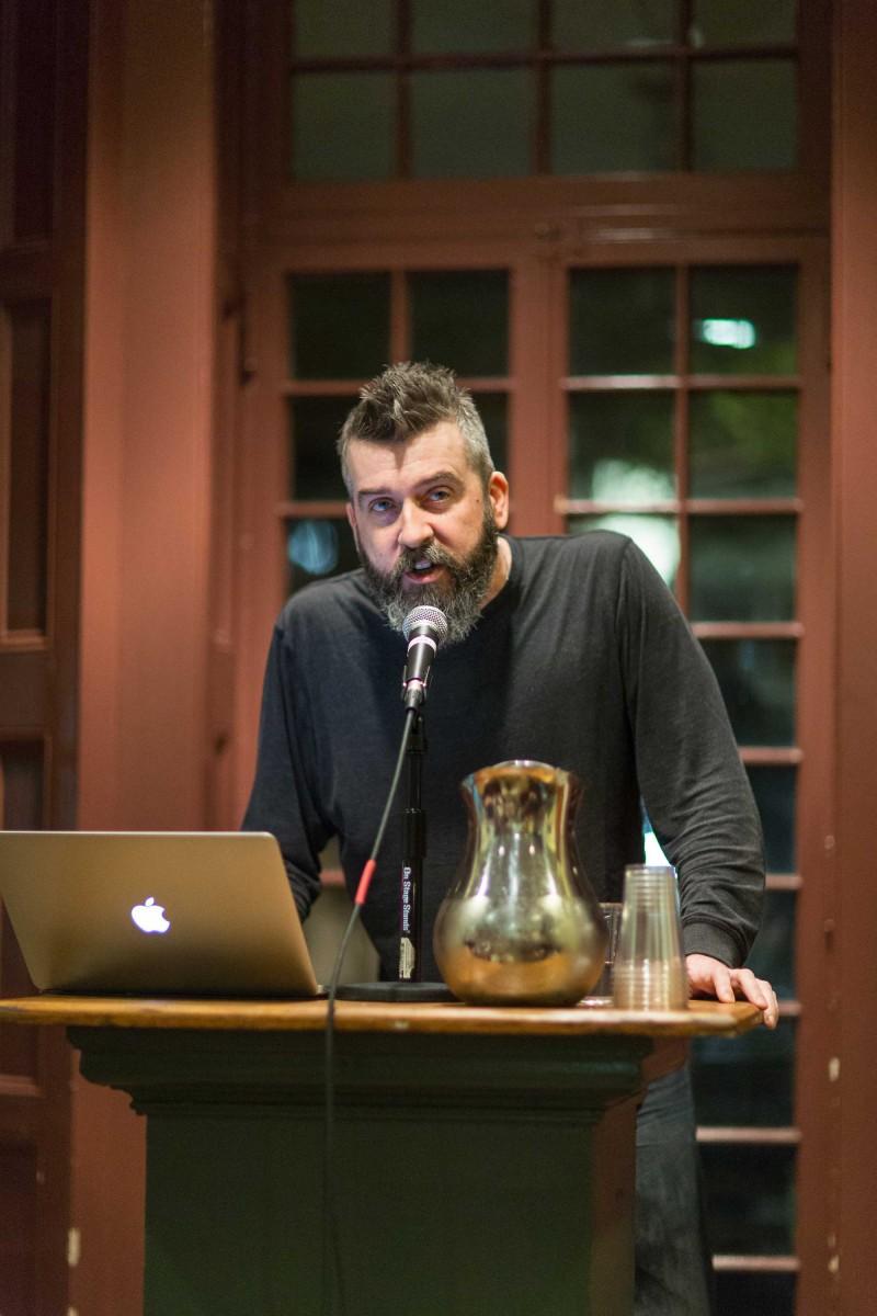 "rank Sherlock presenting his poem No Border No Cry""at the Kelly Writers House, Philadelphia. Photo by Paul Gargagliano of Hazel Photo"