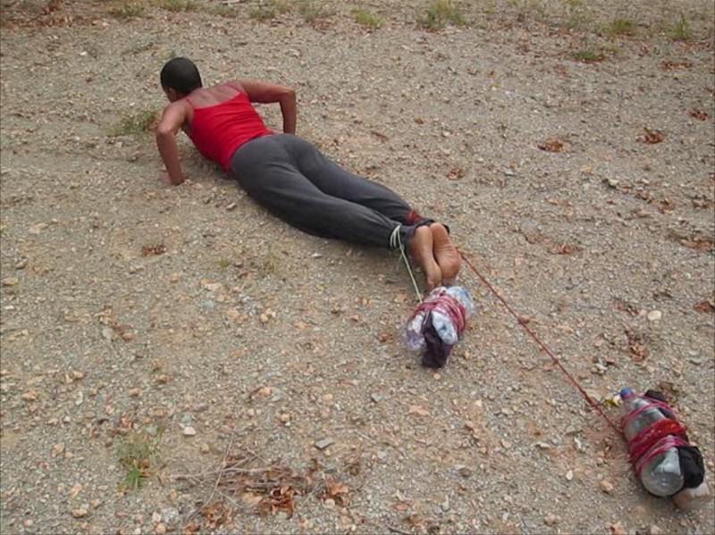 Wura-Natasha Ogunji, belongings. video still, 2007; image courtesy of The Delaware Contemporary