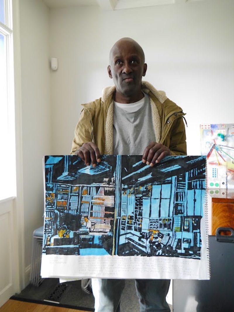 man holding his art