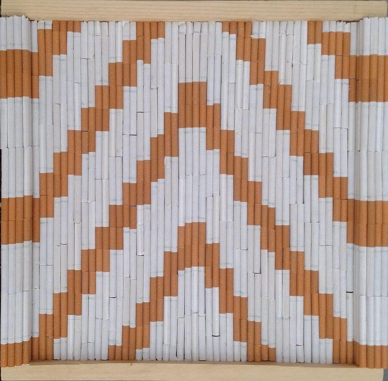 "Untitled Joshua Lascano cigarettes, foam core, wood 16.5"" x 17"" April 2017"
