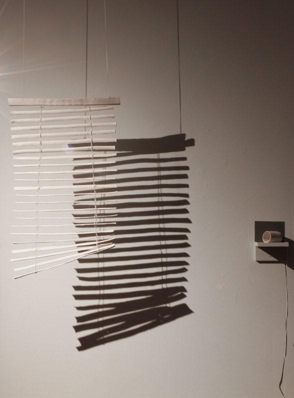 "Jacintha Clark, ""Shape, Shadow, Space"" (detail: blind), 2018, porcelain, string."