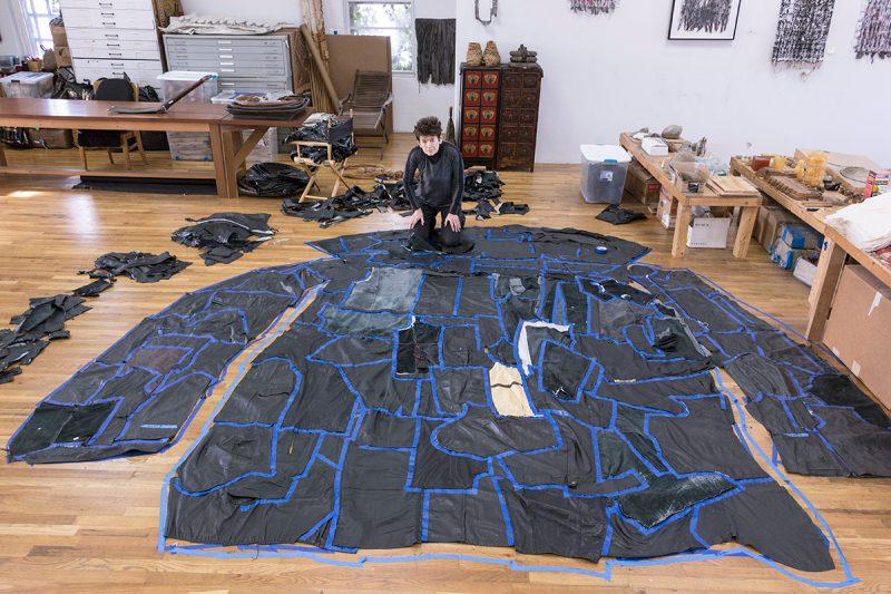 "Ursula von Rydingsvard at work on ""PODERWAĆ"" in her Brooklyn studio. Photo credit Carlos Avendaño."