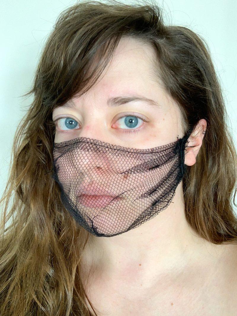 Woman wearing a mesh facemask