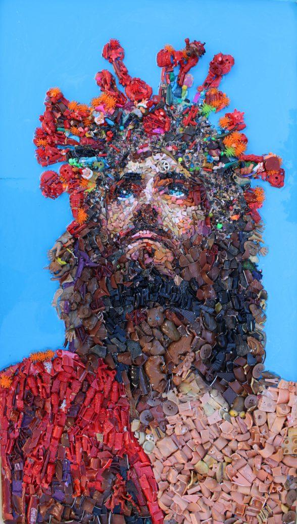 Mosaic portrait of man looking up, wearing crown