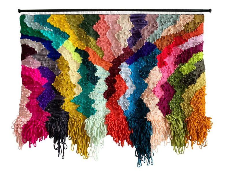 Fabric artwork with blocky zig zag patterns.
