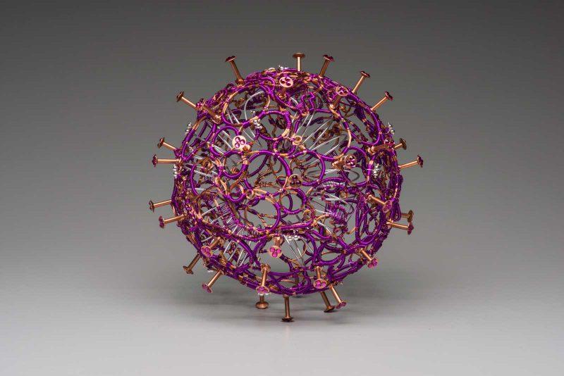 metal sculpture of the covid virus.