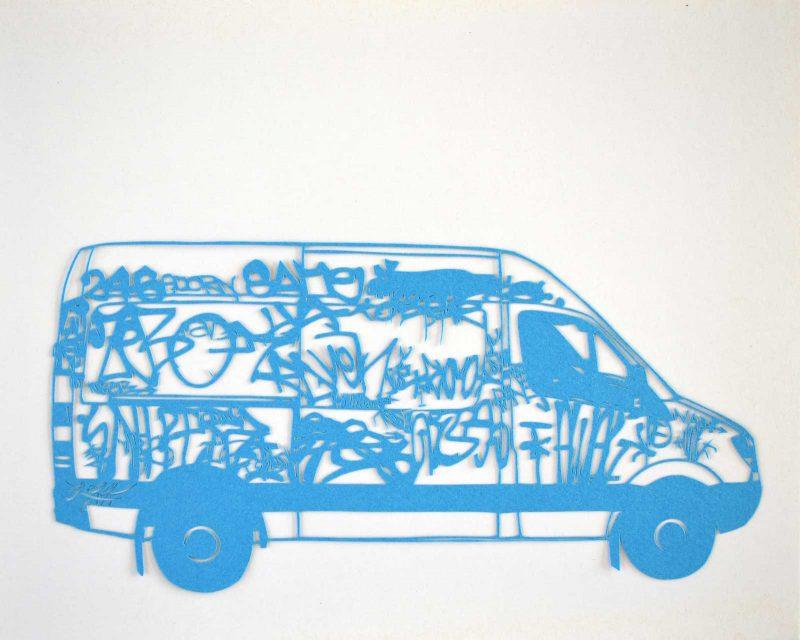 Cut paper artwork of a van covered in graffiti