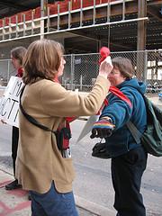 Karen Kappe Nugent puts scarf on Joan Halbert