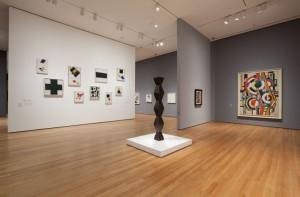 Caption: Foreground: Endless Column, Constantin Brancusi, 1918. Background: Series of Kazimir Malevich paintings. Photo Jonathan Muzikar.