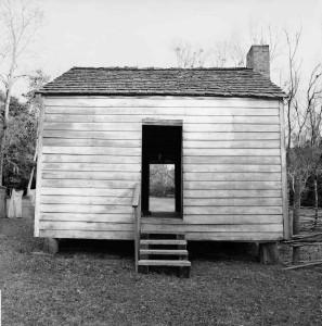 William Earle Williams 'Exterior, Slave Cabin, Oakley Plantation, Saint Francisville, Louisiana,' (2004), gelatin silver print, 7 x 7 in.
