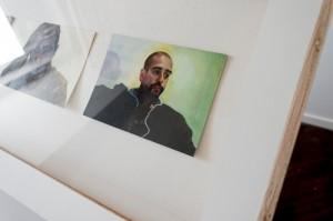 A closeup of some of Salzman's portraits, including the splash of green.