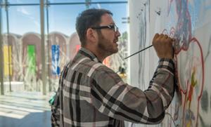 Daniel Heyman, at work on a wall piece at Dartmouth.