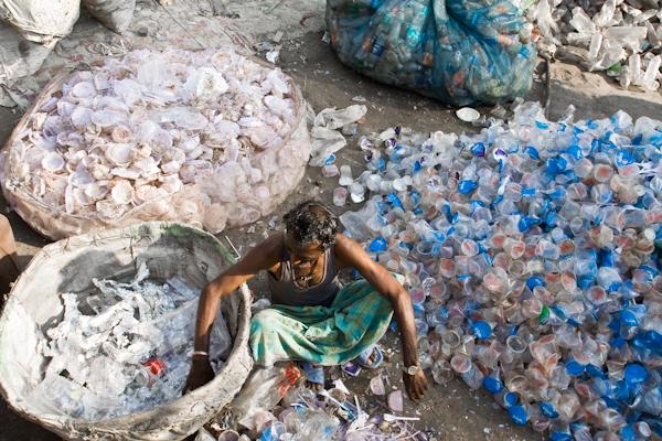 Man sorting plastic bottles. Photo copyright Enrico Fabian.
